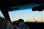 The view of downtown Toronto including the CN Tower as seen from the taxi on the way from the airport into the city.