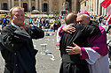Some priests meet in St. Peter's square after the event