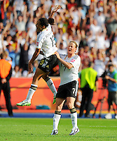 Celia Okoyino da Mbabi (l) celebrates with Melanie Behringer during the FIFA Women's World Cup at the FIFA Stadium in Berlin, Germany on June 26th, 2011.