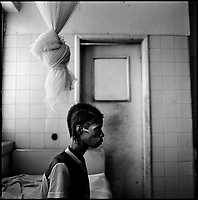 Huambo, Angola, May, 24, 2006.Babena, 25. More than 300 TB patients live in Huambo State Sanatorium, hundreds more are outside patients. TB is endemic in the region, fueled by poverty, malnutrition, inadequate hygiene and the rapid spreading of HIV/AIDS since the end of the civil war in 2002.