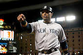 New York Yankees second baseman Robinson Cano (24) gestures to his teammates as he returns to the dugout after scoring the game-winning run in the twelfth inning against the Baltimore Orioles at Oriole Park at Camden Yards in Baltimore, MD on Tuesday, April 10, 2012.  The Yankees won the game in 12 innings 5 - 4..Credit: Ron Sachs / CNP.(RESTRICTION: NO New York or New Jersey Newspapers or newspapers within a 75 mile radius of New York City)