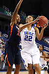 03 March 2016: Duke's Oderah Chidom (22) and Virginia's Aliyah Huland El (23). The Duke University Blue Devils played the University of Virginia Cavaliers at the Greensboro Coliseum in Greensboro, North Carolina in the Atlantic Coast Conference Women's Basketball tournament and a 2015-16 NCAA Division I Women's Basketball game. Duke won the game 57-53.