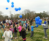NWA Democrat-Gazette/ANDY SHUPE<br /> Wanda Baker (left), 8, a second-grader at Vandergriff Elementary School, holds a bubble wand in the wind Thursday, March 16, 2017, while taking part in a balloon release at the Bob Kraynik Community Sports Complex at the school in Fayetteville. The event was held in remembrance and celebration of Adron Benton, a 6-year-old student at Vandergriff who was found in a nearby swimming pool March 7 and later died.