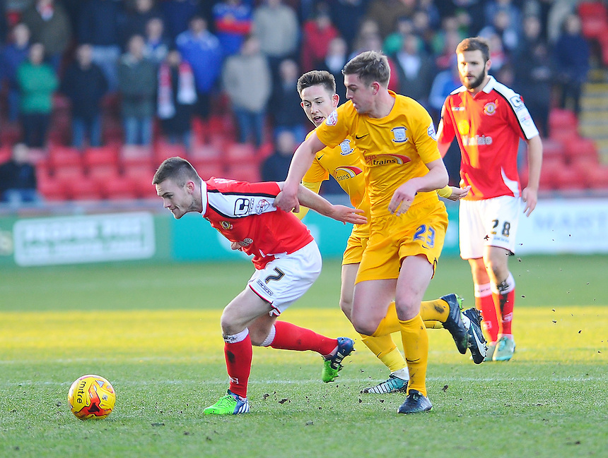 Crewe Alexandra's Oliver Turton battles with Preston North End's Paul Huntington<br /> <br /> Photographer Craig Thomas/CameraSport<br /> <br /> Football - The Football League Sky Bet League One - Crewe Alexandra v Preston North End - Sunday 28th December 2014 - Alexandra Stadium - Crewe<br /> <br /> &copy; CameraSport - 43 Linden Ave. Countesthorpe. Leicester. England. LE8 5PG - Tel: +44 (0) 116 277 4147 - admin@camerasport.com - www.camerasport.com