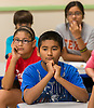 Students participate in the Greater Heights Science Extravaganza at Helms Elementary School, July 27, 2013.