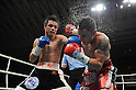 (L-R) Hiroyuki Hisataka (JPN), Hugo Cazares (MEX), DECEMBER 23, 2010 - Boxing : Hiroyuki Hisataka of Japan hits Hugo Fidel Cazares of Mexico during the 8th round of the WBA super flyweight title bout at Osaka Prefectural Gymnasium in Osaka, Osaka, Japan. (Photo by Mikio Nakai/AFLO).