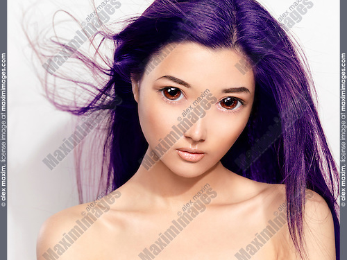 Beauty portrait of a cute young asian woman face with big eyes and flying purple hair retouched in Japanese anime style