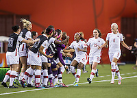 Montreal - June 15, 2015:  Canada (white) lead Netherlands (orange) at half-time in a Women's World Cup match at the Olympic Stadium