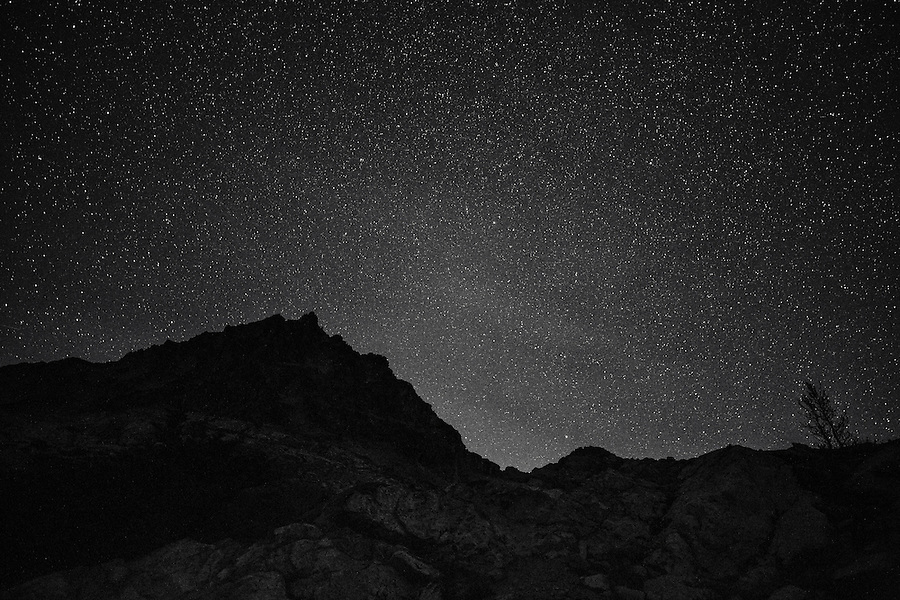 Black Peak at night in monochrome in Washington's North Cascade Mountain range on a clear, starry night in the fall.