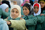 Girls line up before starting school in the Zaatari Refugee Camp, located near Mafraq, Jordan. Opened in July, 2012, the camp holds upwards of 50,000 refugees from the civil war inside Syria, but its numbers are growing. International Orthodox Christian Charities and other members of the ACT Alliance are active in the camp providing essential items and services, including school uniforms.