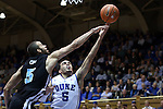 04 November 2014: Duke's Tyus Jones (right) shoots over the outstretched arm of Livingstone's Cristian Henry (left). The Duke University Blue Devils hosted the Livingstone College Blue Bears at Cameron Indoor Stadium in Durham, North Carolina in an NCAA Men's Basketball exhibition game. Duke won the game 115-58.