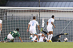 24 September 2013: North Carolina's Brendan Moore (right) makes a save on William and Mary's Roshan Patel (18). The University of North Carolina Tar Heels hosted the College of William and Mary Tribe at Fetzer Field in Chapel Hill, NC in a 2013 NCAA Division I Men's Soccer match. William and Mary won the game 1-0.
