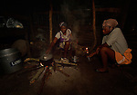 Cebonet Alcide (left) makes coffee in the predawn darkness in Despagne, an isolated village in southern Haiti where the Lutheran World Federation has been working with residents to improve their quality of life. Helping her is her daughter Magdala.