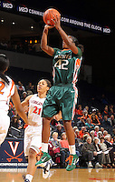 Jan. 6, 2011; Charlottesville, VA, USA; Miami Hurricanes guard Shenise Johnson (42) shoots over Virginia Cavaliers forward Jazmin Pitts (21) during the game at the John Paul Jones Arena.  Mandatory Credit: Andrew Shurtleff-