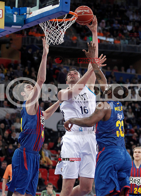 Real Madrid's Mirza Begic (c) and FC Barcelona Regal's Ante Tomic (l) and Pete Mickeal (r) during Spanish Basketball King's Cup match.February 07,2013. (ALTERPHOTOS/Acero) /Nortephoto