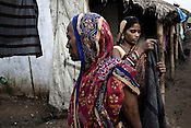 Women are seen doing their daily chores at the transit camp in Badagabapur, in Jagatsinghpur, Orissa. Posco Transit Camp is being set up for people who have been driven out of their villages for being pro-Posco, where they live on the side of a highway on $80 a day shared between 195 people.