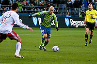 Seattle Sounders Freddie Ljungberg (c) moves the ball upfield aginst Mike Petke (12) as the Seattle Sounders lost to the New York Red Bulls, 1-0, in an MLS match on Saturday, April 3, 2010 at Qwest Field in Seattle, WA.