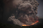 Nighttime view of major dome collapse at Sinabung Volcano causing large sequence of pyroclastic flows, Sunatra, Indonesia