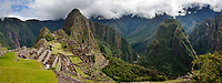 """Huayanapichu (young mountain) in the distance at Machu Picchu, the ancient """"lost city of the Incas"""", 1400 CA, 2400 metersl. Discovered by Hiram Bingham in 1911. One of Peru's top tourist destinations."""