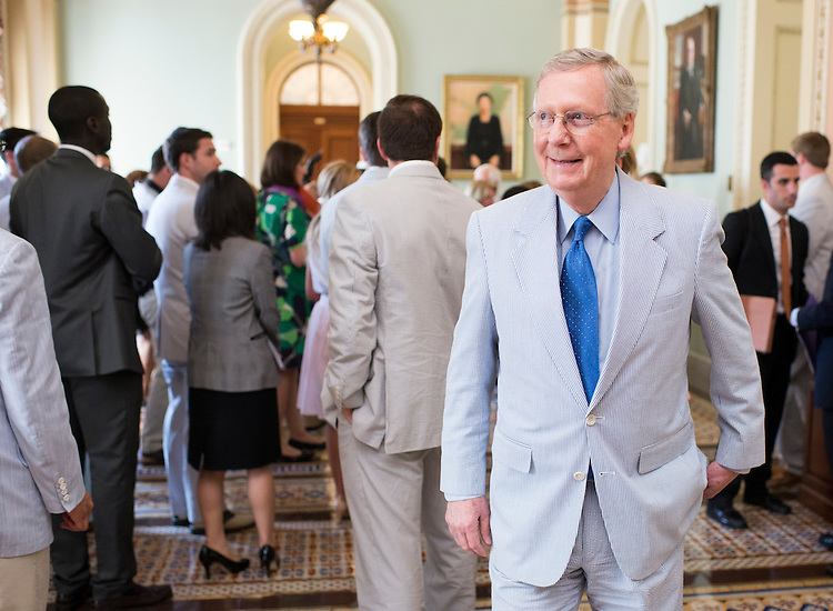 UNITED STATES - JUNE 11: Senate Majority Leader Mitch McConnell, R-Ky., walks back to his office after participating in the Official National Seersucker Day Photograph in celebration of National Seersucker Day on Thursday, June 11, 2015. (Photo By Bill Clark/CQ Roll Call)