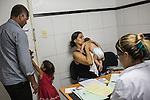 RECIFE, BRAZIL - JANUARY 8: Jusikelly da Silva, 32, with nine-week-old Luhandra, who is a zika-related microcephaly case, and her husband, Josenildo da Silva, 43, and daughter, (at left) at a follow up visit with pediatrics doctor Danielle Cruz at The Professor Fernando Figueira Institute of Medicine, a public hospital in Recife, Pernambuco, Brazil, on Friday, Jan. 8, 2016. <br /> <br /> The mosquito-borne Zika virus continues to spread in Brazil, alarming health officials and expecting mothers that their babies will be born with abnormal brain development called microcephaly. While researchers have yet to make a connection, Brazil has the highest number of babies born with mircocephaly - the most cases in Recife, Pernambuco - from mothers who tested positive to the Zika virus.  There are about 3,530 suspected cases of zika-related microcephaly in Brazil.