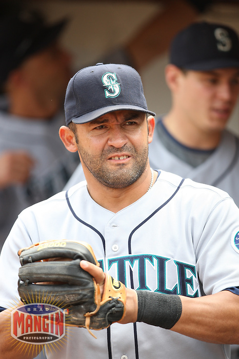 OAKLAND, CA - SEPTEMBER 20:  Miguel Cairo of the Seattle Mariners gets ready in the dugout before the game against the Oakland Athletics at the McAfee Coliseum in Oakland, California on September 20, 2008.  The Athletics defeated the Mariners 8-7.  Photo by Brad Mangin