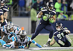 Seattle Seahawks running back Thomas Rawls (34) breaks the tackles of Carolina Panthers on his way to a 13-yard gain in the third quarter at CenturyLink Field in Seattle, Washington on December 4, 2016.  Rawls ran for 105 yards on 16 carries and scored two touchdowns in the Seahawks 40-7 win over the Panthers.  ©2016. Jim Bryant photo. All Rights Reserved.