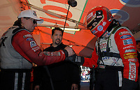 "Jan 20, 2007; Las Vegas, NV, USA; NHRA Funny Car driver Ashley Force shakes hands with her father John Force prior to her first run during preseason testing at ""The Strip"" at Las Vegas Motor Speedway in Las Vegas, NV. Mandatory Credit: Mark J. Rebilas"