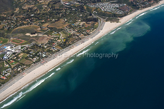 Aerial view of the Malibu Coast, looking east, just north of Point Dume, with ocean currents off the coast.