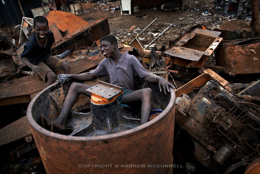 Children take a break from burning cables at Agbogbloshie dump, in Accra, Ghana.