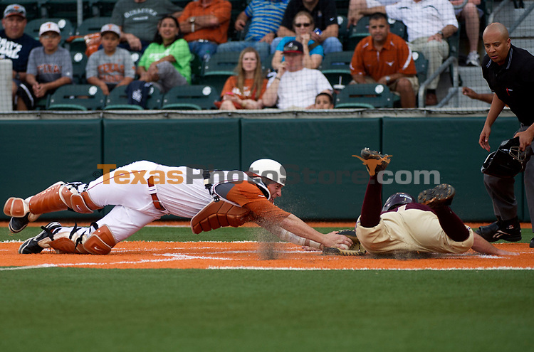 Texas' Jacob Felts dives to make an out at home plate against Texas State's #1 during the Texas Longhorns matchup against Texas State in Austin on Tuesday.