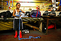 Stevie Galeano, age 7 wraps his hands in preparation for a workout at the Ft. Apache boxing gym July 27, 2006 in the South Bronx-New York, NY. (Photo by Scott Nelson/WPN)
