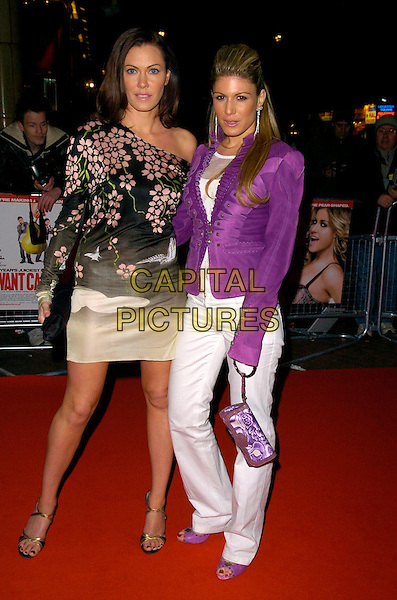 LINZI STOPPARD & HOFIT GOLAN.Attending I Want Candy Premiere, Vue West End, London, UK..March 20th, 2007.full length white trousers purple jacket shoes purse bag brown floral print off the shoulder dress pink beige.CAP/CAN.©Can Nguyen/Capital Pictures