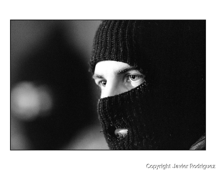Zapatista rebel Subcomandante Marcos pauses as he attends a press conference at the venue of peace talks in San Cristobal las Casas Cathedral, February 22, 1994. Photo by Javier Rodriguez