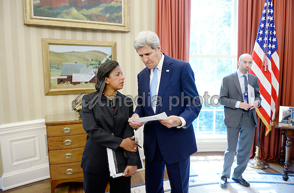 United States Secretary of State John Kerry speaks with National Security Adviser Susan Rice during a bilateral meeting in the Oval Office of the White House between US President Barack Obama and King Salman bin Abd alAziz of Saudi Arabia at the White House September 4, 2015 in Washington, D.C. Photo Credit: Olivier Douliery/CNP/AdMedia