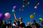 Balloons are released by family and friends, including his youngest sister Janis Schewe (center, blonde), at the memorial service for Sun City resident Monte Haag, who moved to Sun City in 2000 and died in December 2010. He died in a crash flying an ultralight plane outside of Sun City. The service was held in Social Hall No. 1 of the Bell Recreation Center and then balloons were released at the tennis courts Monte frequented in Sun City, Arizona December 11, 2010...2010 marks the 50th anniversary of Sun City, America's first retirement city that remains the largest today with more than 40,000 residents 55 and older.