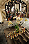 """Flowers in the lobby of a cozy, inn in  in Antigua, Guatemala  during colorful and festive """"Semana Santa"""" (Saint week). ..Antigua, a colonial town, is a UNESCO World Heritage site."""