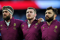 Geoff Parling, Ben Morgan and Alex Corbisiero of England sing the national anthem. QBE International match between England and France on August 15, 2015 at Twickenham Stadium in London, England. Photo by: Patrick Khachfe / Onside Images