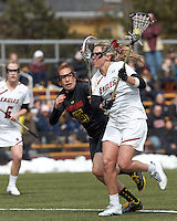 Boston College attacker Covie Stanwick (8) on the attack as University of Maryland defender Melissa Diepold (15) defends..University of Maryland (black) defeated Boston College (white), 13-5, on the Newton Campus Lacrosse Field at Boston College, on March 16, 2013.