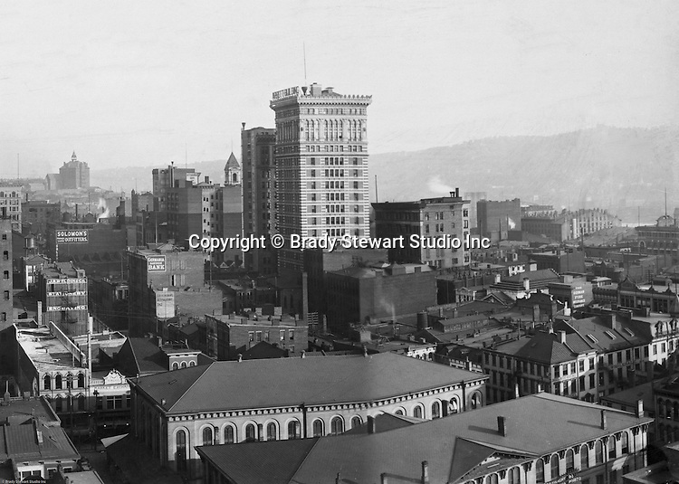 Pittsburgh PA:  View of City from the top of the Empire Building - 1904. View of the city toward the Monongahela River.   Arrott Building dominates the skyline.  Company signs on the city buildings include: J.R. Weldin & Company Stationery and Engraving, Solomon's Outfitters, The German Fire Insurance Company, and the Peoples Savings Bank.  Keystone Bank Building sits right next to the Arrott Building on Fourth Avenue.