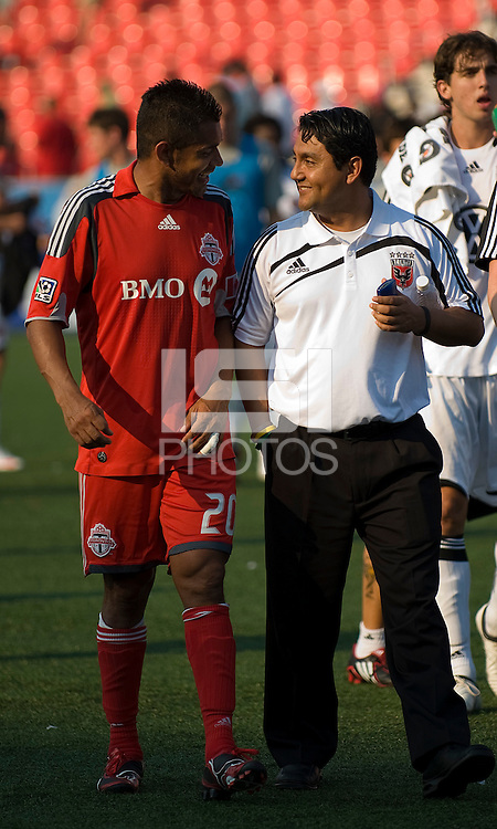 15 August 2009: Toronto FC midfielder Amado Guevara #20 talks with one of the D.C. United training staff at the end of the MLS game at BMO Field in Toronto between D.C. United and Toronto FC..Toronto FC won 2-0..Photo by Nick Turchiaro/isiphotos.com.