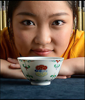 BNPS.co.uk (01202 558833)Pic: Woolley&amp;Wallis/BNPS<br /> <br /> Jasmine Lin from Woolley &amp; Wallis took the chinese phone bid.<br /> <br /> Bidding frenzy over a wine cup.<br /> <br /> A tiny 10cm wine cup has astonished auctioneers by selling for nearly &pound;500,000.<br /> <br /> The chinese porcelain Lingzhi or wine bowl dating from the early 18th century sold for &pound;482,800 at Woolley &amp; Wallis auctioneers in Salisbury on friday.