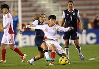BOCA RATON, FL - DECEMBER 15, 2012: Tobinn Heath (17) of the USA WNT tackles Han Peng (18) of China WNT during an international friendly match at FAU Stadium, in Boca Raton, Florida, on Saturday, December 15, 2012. USA won 4-1.