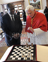 Pope Benedict XVI poses with Ivory Coast President Alassane Ouattara during a private audience on November 16, 2012 at the Vatican.