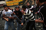 A man was injured when he tried to jump from a burning building on a street where protesters and police clashed, Cairo, Egypt, Friday, Jan. 28, 2011. Tens of thousands of people took to the streets after Friday prayers, demanding that President Hosni Mubarak step down. Demonstrators clashed with police throughout the day and night as they marched toward Tahrir Square.