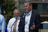 Tuesday, May 12, 2009.  Mission Beach, San Diego, CA, USA.  Kevin Faulconer speaks to the media as Mayor Jerry Sanders looks on.  District 2 councilmember Kevin Faulconer announced today that he plans to use $80K of discretionary funds to continue a long-standing program of supplemental trash pick-ups from residents in Mission Beach during the summer months.