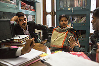 The Guria legal team prepares Brinda to fight the defending lawyers during her final witness court appearance in the Guria office in Varanasi, Uttar Pradesh, India on 23 November 2013. She is one of the 57 underaged and trafficked girls rescued from the Shivdaspur red light area in Varanasi, who has been fighting a court case against her traffickers and brothel owners for the past 8 years.