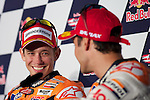 Honda Repsol pilot Casey Stoner from Australia and Dani Pedrosa of Spain share a laugh during the MotoGP post race press conference, Sunday, July 29, 2012.