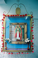 La Virgen de Guadalupe (the Virgin of Guadalupe) hangs on one of the walls next to the ring in the Gimnasio Latinoamericano.  The Virgin is revered in almost all aspects of life in Mexico.