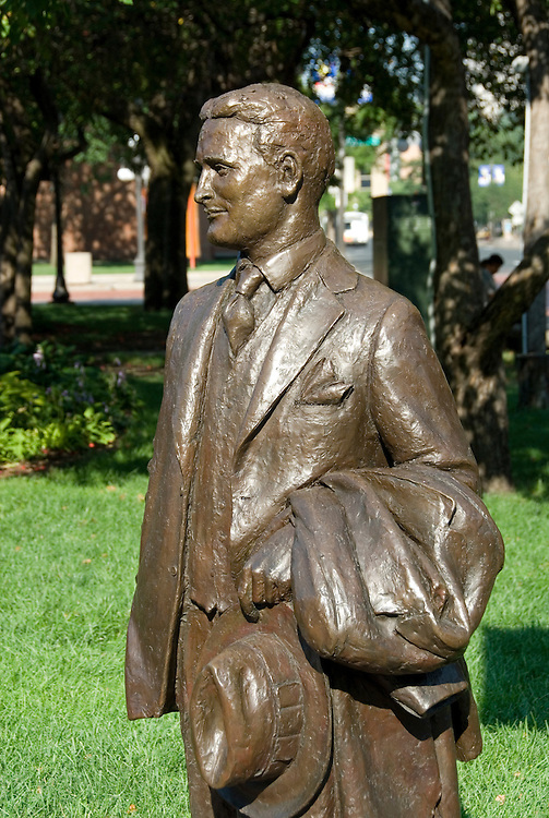 Minnesota, Twin Cities, Minneapolis-Saint Paul: F Scott Fitzgerald, author, statue in Rice Park in St. Paul.  Fitzgerald was a St. Paul native and wrote The Great Gatsby and other novels..Photo mnqual301-75294..Photo copyright Lee Foster, www.fostertravel.com, 510-549-2202, lee@fostertravel.com.